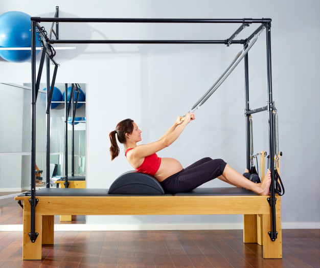 Exercice : Roll up  sur pilates cadillac